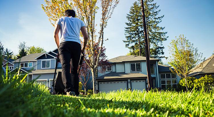 Homeowner mowing lawn